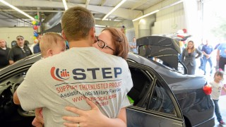Navy electrician Brandon Walker, his wife Kyla and their daughter Kira hug after the couple receiving a refurbished 2012 Toyota Corolla from Caliber Collision Center and Esurance on Tuesday in Rancho Cucamonga. The couple didn't have a reliable vehicle for taking Kira, who was born with kidney and brain damage, to the hospital. The couple also have a 3-year old daughter — Zoey, at right. Will Lester — staff photographer