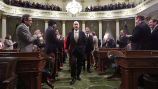 Gov. Jerry Brown receives applause from lawmakers as he walks to podium of the Assembly chambers to deliver his State of the State address at the Capitol in Sacramento, Calif., Wednesday, Jan. 22, 2014. (Rich Pedroncelli / AP)