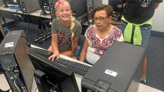 A junior high student works with a senior at Alta Loma High School as part of the Cyber Seniors program in Rancho Cucamonga. Courtesy photo