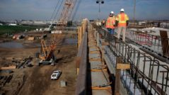 A construction crew works on an elevated section of track for the high-speed rail system in Fresno in February. Photo: Michael Macor, The Chronicle